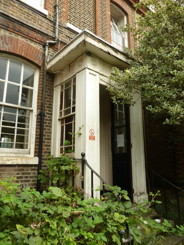 Victorian Porch on rear entrance to the building