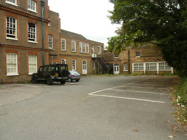 The front driveway of Chestnuts House, showing the northern range and stables block, July 2013
