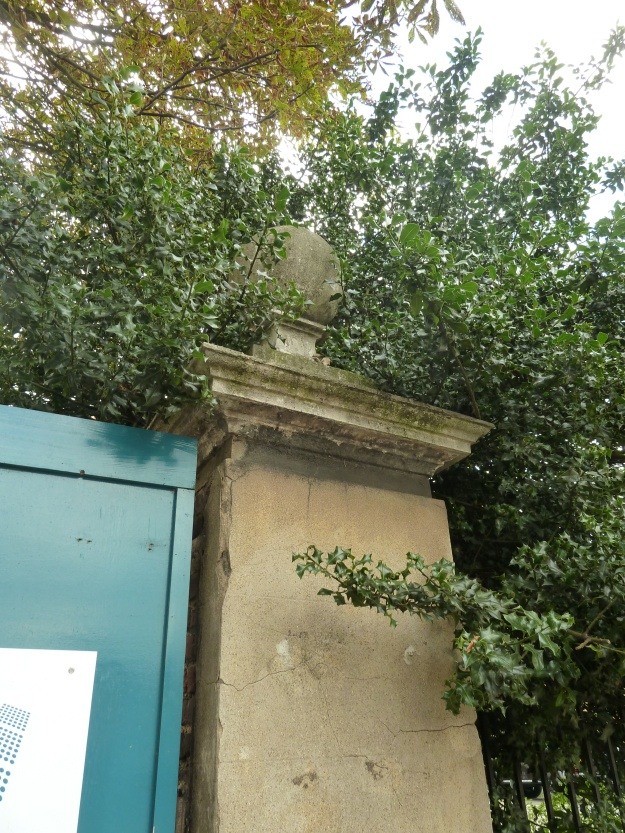 One of the ball topped gateposts fronting Hoe Street. Along with the rest of the building, these gateposts are listed at Grade 2*