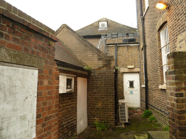 The grouping of outbuildings to the rear of the stables block